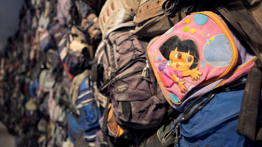 "A Dora the Explorer backpack is one of hundreds of backpacks left behind by migrants illegally crossing the U.S.-Mexican border on display in the ""State of Exception"" exhibit, Friday, Feb. 10, 2017 in New York. The exhibit at the Sheila C. Johnson Design Center at the Parsons School of Design continues through April 17."