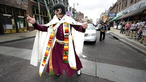 """Dorian Baxter, who is also known as """"The Reverend Elvis Priestly"""", leads a parade down Beale Street in August 2016  to honor the late King of Rock and Roll, Elvis Presley. Baxter was ordained an Anglican Priest in 1983 and uses the music of Elvis Presley at his services at Christ the King Graceland Church in Newmarket, Ontario."""