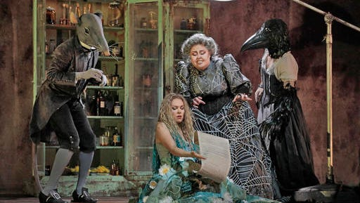 "This Jan. 24, 2017 image released by the Metropolitan Opera shows mezzo-soprano Jamie Barton, as the witch Jezibaba, standing, with soprano Kristine Opolais, as the water nymph Rusalka, in Dvorak's opera ""Rusalka."" It will be broadcast live in HD from the Metropolitan Opera on Feb. 25."