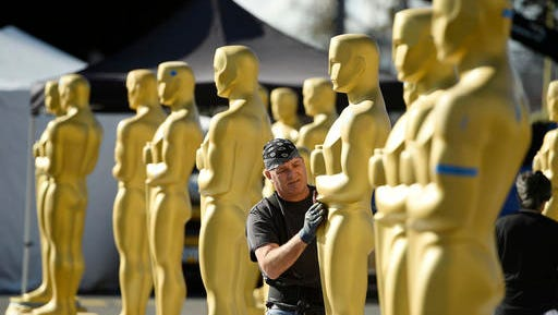 Scenic artist Rick Roberts of Local 800 primps Oscar statues near the Dolby Theatre on Wednesday, Feb. 22, 2017, in Los Angeles. The 89th Academy Awards will be held on Sunday.