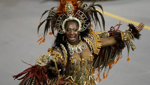 A dancer from the Academicos do Tatuape samba school performs during a carnival parade in Sao Paulo, Brazil, early Saturday, Feb. 25, 2017.