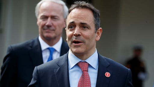 Arkansas Gov. Asa Hutchinson listens at left as Kentucky Gov. Matt Bevin speaks to reporters outside the White House in Washington, Monday, Feb. 27, 2017, following a meeting with President Donald Trump inside. (AP Photo/Evan Vucci)