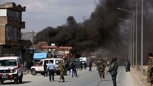 Smoke rises from a district police headquarters after a suicide bombing in Kabul, Afghanistan, Wednesday, March 1, 2017. An Afghan official says that a suicide car bomber attacked at the gates of a police station in the western part of the capital, Kabul.