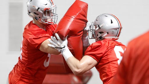 Ohio State tight ends Jake Hausmann, left, and A.J. Alexander run a blocking drill during spring NCAA college football practice Tuesday, March 7, 2017, in Columbus, Ohio. (AP Photo/Jay LaPrete)