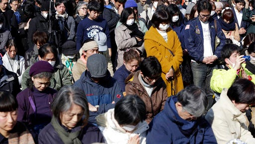 People mourn the victims of the March 11, 2011 earthquake and tsunami during a special memorial event in Tokyo, Saturday, March 11, 2017. Japan on Saturday marked the sixth anniversary of the 2011 tsunami that killed more than 18,000 people and left a devastated coastline along the country's northeast that has still not been fully rebuilt.