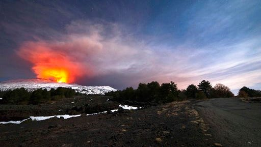 Mount Etna, Europe's most active volcano, is seen from the side of a road as it spews lava during an eruption in the early hours of Thursday, March 16, 2017. A new eruption which began on March 15 is causing no damages to Catania's airport which is fully operational.