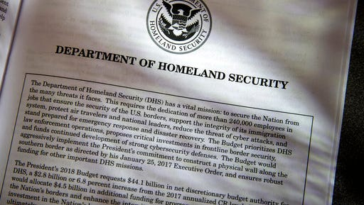 Proposals for the Homeland Security Department in President Donald Trump's first budget are displayed at the Government Printing Office in Washington, Thursday, March, 16, 2017. President Donald Trump's budget proposals on immigration enforcement read like a wish list for his most ardent supporters. The budget requests for the Homeland Security and Justice departments call for billions of dollars for some of Trump's most high-profile and contentious campaign promises, including a $2.6 billion down payment for a border wall he insisted Mexico would pay for.