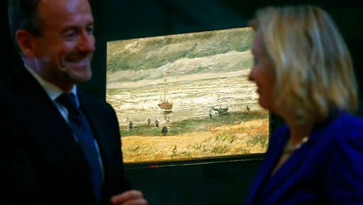 """Van Gogh Museum director Axel Rueger, left, and Jet Bussemaker, Minister for Education, Culture and Science, stand next to the stolen and recovered """"Seascape at Scheveningen"""" by Dutch master Vincent van Gogh, during a press conference in Amsterdam, Netherlands, Tuesday, March 21, 2017. Two paintings by Vincent van Gogh titled """"Seascape at Scheveningen"""" (1882) and """"Congregation leaving the Reformed Church in Nuenen,"""" (1884-1885) returned to the Amsterdam museum after they were stolen from in a nighttime heist 15 years ago and recovered by Naples police in Italy."""