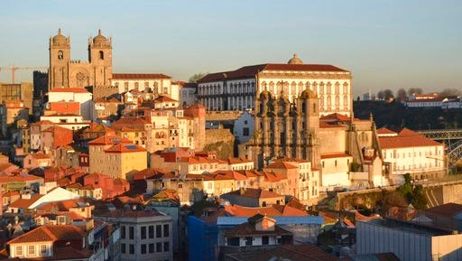 This Feb. 16, 2017 photo shows Porto, Portugal, from the Vitoria lookout point. Spectacular sunsets are a major tourist attraction and places to view them are labeled on maps as miradouros.