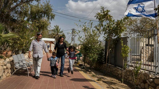 Venezuelan Jewish converts Franklin Perez and his wife Sahir Quitero, son Ezra and daughter Hannah walk inside an absorption center in the southern city of Beersheba, Israel, Thursday, March 23, 2017. For a group of nine struggling Venezuelan converts to Judaism their torturous journey to a better life in the promised land finally brought them to Israel on Thursday. They immigrated under the Law of Return, which gives Jews the world over the right to settle in Israel, Israel, Thursday, March 23, 2017.