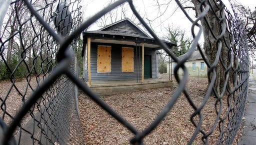 FILE - In this Jan. 16, 2017, file photo, the abandoned childhood home of singer Aretha Franklin sits behind a security fence in Memphis, Tenn. Recently, the Franklin birthplace and the surrounding neighborhoods have moved to the forefront of a large cleanup effort, as the city refuses to accept decay as a fact of life in the urban landscape.