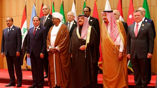 A section of twenty one kings, presidents and top officials from the Arab League summit pose for a group photo, at a gathering near the Dead Sea in Jordan on Wednesday, March 29, 2017. With the exception of Syria, whose chair sits empty, all Arab states are participating in the annual event aiming to work on regional solutions to conflicts in Yemen, Libya, Iraq and Syria while tackling extremism, poverty and worries over the new American administration.