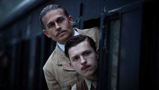 """This image released by Amazon Studios/Bleecker Street Films shows Tom Holland, foreground, and Charlie Hunnam in a scene from """"The Lost City of Z."""""""