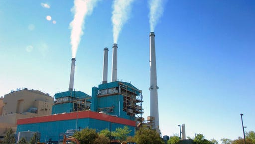 Coal fired power plants, like this one in Colstrip, Mont., are believed to contribute to global warming.