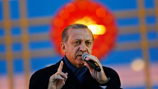 Turkey's President Recep Tayyip Erdogan, gestures while delivering a speech during a rally of supporters a day after the referendum, outside the Presidential Palace, in Ankara, Turkey, Monday, April 17, 2017. Turkey's main opposition party urged the country's electoral board Monday to cancel the results of a landmark referendum that granted sweeping new powers to Erdogan, citing what it called substantial voting irregularities.