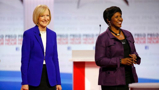 """FILE - In this Feb. 11, 2016 file photo, moderators Judy Woodruff, left, and Gwen Ifill appear before a Democratic presidential primary debate at the University of Wisconsin-Milwaukee in Milwaukee. Arizona State University is awarding its Walter Cronkite Award for Excellence in Journalism for 2017 to Woodruff and the late Ifill, co-anchors and managing editors of the """"PBS NewsHour."""" An announcement Monday, April 17, 2017, by university's Walter Cronkite School of Journalism and Mass Communication says Woodruff will accept the award for herself and Ifill during an Oct. 19 luncheon in Phoenix."""