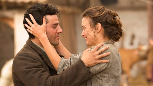 "Oscar Isaac , left, and Charlotte Le Bon star in  ""The Promise."" The film opens Thursday at Regal West Manchester Stadium 13 and Friday at R/C Hanover Movies."