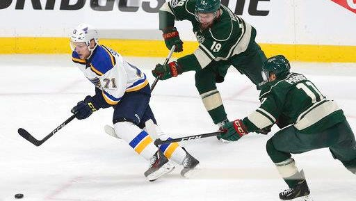 St. Louis Blues' Vladimir Sobotka (71) controls the puck in front of Minnesota Wild's Martin Hanzal (19) and Zach Parise (11) during overtime in Game 5 of an NHL hockey Stanley Cup first-round playoff series Saturday, April 22, 2017, in St. Paul, Minn. St. Louis won 4-3.