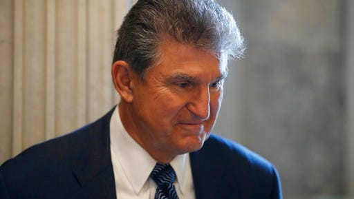 Sen. Joe Manchin, D-W. Va. listens to a reporter's question before a policy luncheon on Capitol Hill in Washington, Tuesday, April 25, 2017.