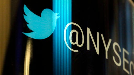 FILE - In this Thursday, Oct. 27, 2016, file photo, the Twitter logo appears on a phone post on the floor of the New York Stock Exchange. Twitter's frequent presence in the news, as the preferred megaphone for President Donald Trump, has not translated into profit or meaningful user growth for the company. Twitter, Inc. reports earnings on Wednesday, April 26, 2017.