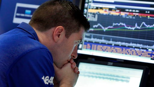 FILE - In this Thursday, March 30, 2017, file photo, specialist Thomas McArdle works at his post on the floor of the New York Stock Exchange. If the market is having a good year and your portfolio isn't, you may want to look at yourself. Psychologists have found behaviors that hurt how we invest, but there are steps you can take to avoid a drag on your portfolio.
