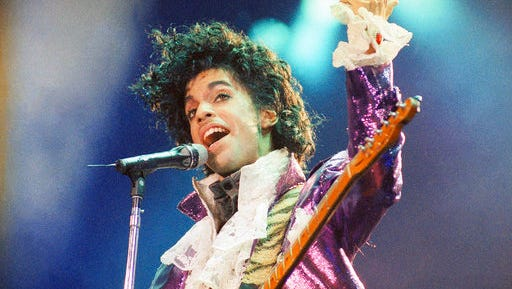 """FILE - In this Feb. 18, 1985 file photo, Prince performs at the Forum in Inglewood, Calif. A pair of record labels announced Friday, April 28, 2017, that a remastered edition of Prince's landmark 1984 album """"Purple Rain"""" will be released on June 23, 2017. The labels say Prince oversaw the remastering process in 2015 and the """"Purple Rain Deluxe"""" will include six previously unreleased songs by the late singer-songwriter, who died one year ago."""