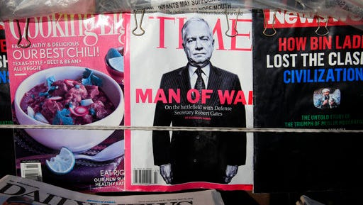 FILE - In this April 29, 2010 file photo, an issue of Time Magazine is shown on a newsstand, in New York.   Time's stock is plummeting after the publisher said its board is not considering a sale of the company. The New York-based company said Friday, April 28, 2017,  that a number of parties expressed interest in the business, but no sale process was ever begun.