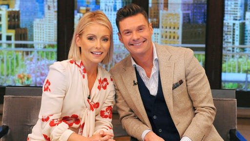 """In this photo released by Disney/ABC Home Entertainment and TV Distribution, Kelly Ripa and Ryan Seacrest pose for a photo at """"Live"""" on Monday, May 1, 2017, in New York. Seacrest was named co-host of the morning chat show, ending a yearlong search for a marquee name as Michael Strahan's successor."""