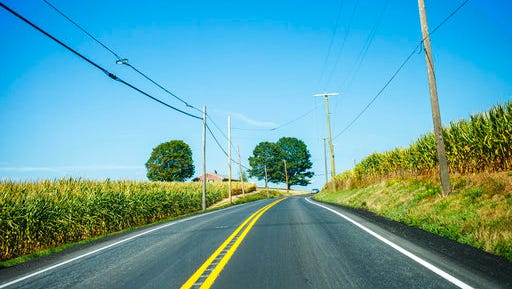In this Aug. 29, 2016 photo, a two lane road rises up toward trees somewhere between Pittsburgh and Gettysburg, Penn.