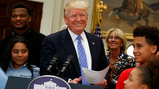 President Donald Trump, accompanied by Education Secretary Betsy DeVos,  arrives to speak during a school choice event in the Roosevelt Room of the White House in Washington, Wednesday, May 3, 2017.