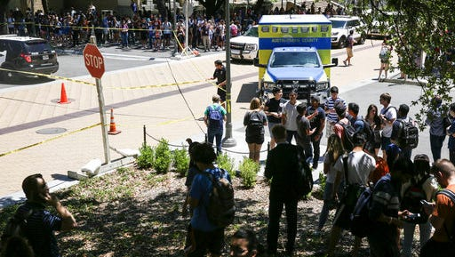 FILE - In this Monday, May, 1, 2017, file photo, law enforcement officers secure the scene after a fatal stabbing attack on the University of Texas campus. The nightmare scenario of a knife wielding attacker put Texas' college campus concealed carry law to the test but provided no real conclusion. Both gun rights and gun control activists insist the attack bolstered their argument that guns do or don't belong on campus. (Tamir Kalifa/Austin American-Statesman via AP)