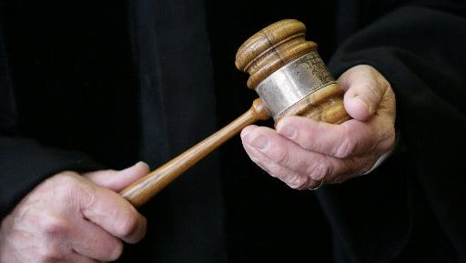 Judge holding a gavel.