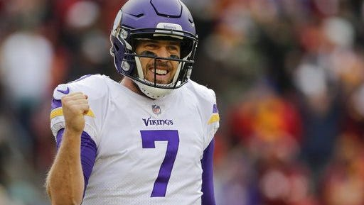 Minnesota Vikings quarterback Case Keenum (7) celebrates wide receiver Jarius Wright's touchdown during the second half of an NFL football game against the Washington Redskins in Landover, Md., Sunday, Nov. 12, 2017.