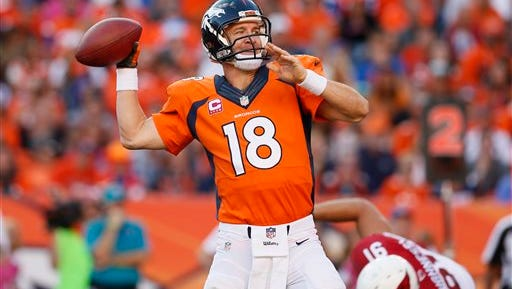FILE - In this Oct. 5, 2014, file photo, Denver Broncos quarterback Peyton Manning (18) throws against the Arizona Cardinals during the second half of an NFL football game, in Denver. The Broncos won 41-20. Brett Favre says he couldn't be happier to see Peyton Manning on the brink of breaking his own NFL record of 508 touchdown throws. Manning has 503 heading into Denver's road game Sunday Oct. 12 against the New York Jets. (AP Photo/Joe Mahoney, File)