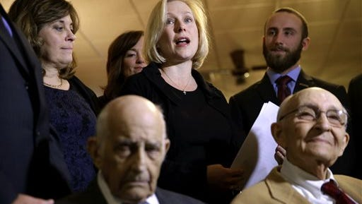 Sen. Kirsten Gillibrand, center, speaks during a ceremony to award Leonard Stern, 88, bottom left, the Purple Heart in Wantagh, on Monday. Gillibrand is making another bipartisan push to change how the military handles allegations of sexual assault.