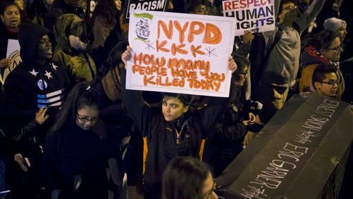 Demonstrators march across the Brooklyn Bridge during a protest against a grand jury's decision not to indict the police officer involved in the death of Eric Garner Thursday.