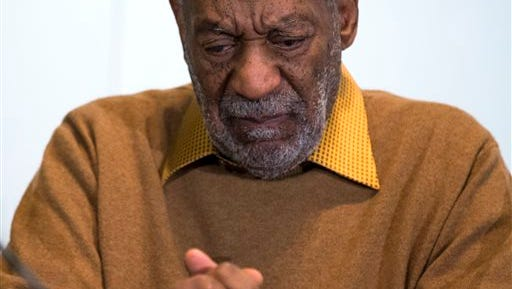 "FILE - In this Nov. 6, 2014 file photo, entertainer Bill Cosby pauses during a news conference. Cosby's attorney said Sunday, Nov. 16, 2014 that Cosby will not dignify ""decade-old, discredited"" claims of sexual abuse with a response, the first reaction from the comedian to an increasing uproar over allegations that he sexually assaulted several women in the past.  (AP Photo/Evan Vucci, File)"