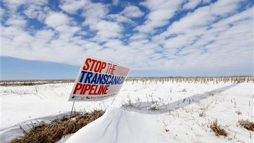 """FILE - In this March 11, 2013 file photo, a sign reading """"Stop the Transcanada Pipeline"""" stands in a field near Bradshaw, Neb., along the Keystone XL pipeline route through the state. With the clock ticking, supporters of a Senate bill to approve the Keystone XL pipeline are still scrambling to find the last vote.  (AP Photo/Nati Harnik, File)"""