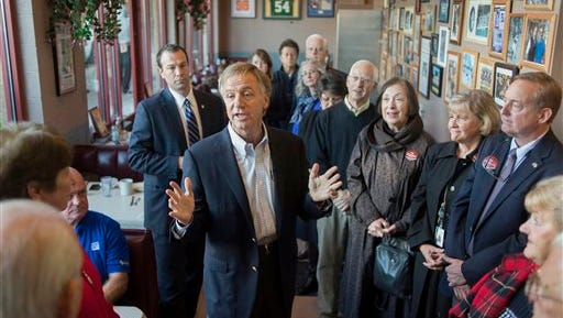 Gov. Bill Haslam talks to diners at Pete's Coffee Shop during a campaign stop Monday, Nov. 3, 2014, in Knoxville, Tenn. The governor kicked off a statewide election eve campaign for re-election at the diner where he originally announced his candidacy in 2009. (AP Photo/The Knoxville News Sentinel, Paul Efird)