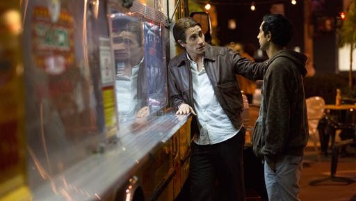 """In this image released by Open Road Films, Jake Gyllenhaal, left, and Riz Ahmed appear in a scene from the film, """"Nightcrawler."""" (AP Photo/Open Road Films, Chuck Zlotnick)"""