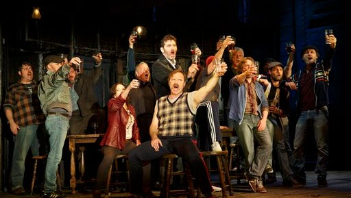 """This photo provided by Sam Rudy Media Relations shows, Jimmy Nail, standing center, and cast in a scene from the play, """"The Last Ship."""" The show is Sting's semi-autobiographical story about a prodigal son who returns to his northern England shipbuilding town to reclaim the girl he abandoned when he fled 15 years before. (AP Photo/Sam Rudy Media Relations, Joan Marcus)"""