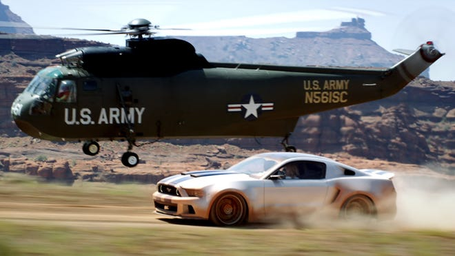 This image released by DreamWorks II shows a Mustang racing as a helicopter flies by in 'Need for Speed'