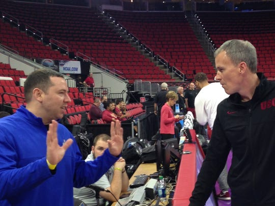 FGCU assistant coach Michael Fly, left, talks with current USC head coach and former FGCU head coach Andy Enfield during NCAA tournament practice Wednesday, March 16, 2016, at PNC Arena in Raleigh, North Carolina.