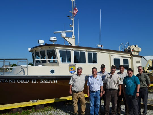 Pete Lacomb of the Baird Maritime Vessel crew, left, joins U.S. Fish & Wildlife Service personnel in Kewaunee for the Stanford H. Smith's welcoming arrival June 27. They include initial project leader Mark Holey (retired), Ryan Wehse, Dale Hanson, Ted Dreska, Capt. Stormi Sutter and Rob Elliott.