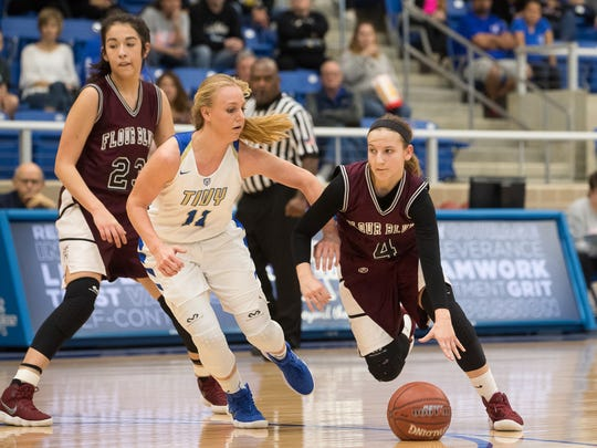 Flour Bluff's Meredith Marcum drives the ball past Kerrville's Charli Becker during the third quarter of the Region IV-5A girls final at the Northside Sports Gym in San Antonio on Saturday, Feb. 24, 2018.