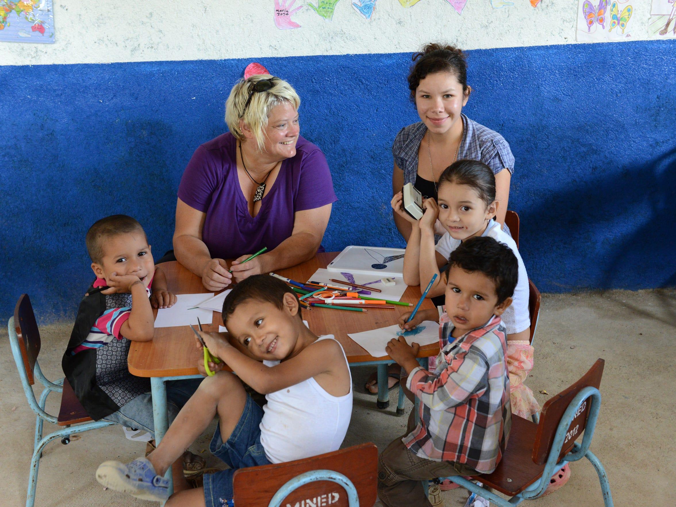 Children of Las Minitas and their teacher, Marisela, with the writer, left.