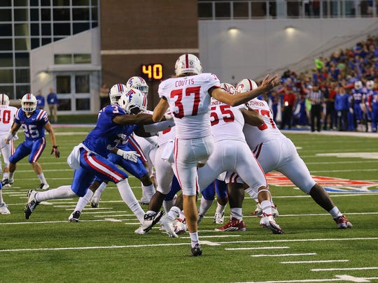 Louisiana Tech wide receiver Paul Turner, left, blocks a punt for a safety Saturday during the Bulldogs' win over UL.