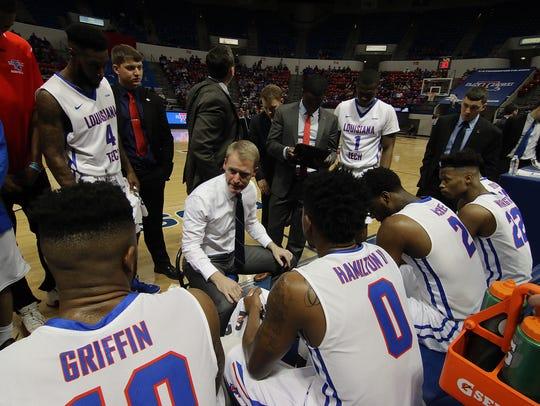 Louisiana Tech coach Eric Konkol, center, talks to