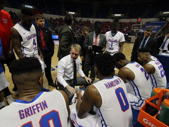 Louisiana Tech coach Eric Konkol, center, talks to