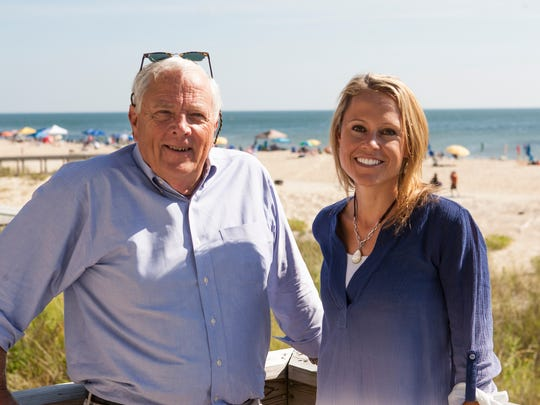 """T.J. Healy, chair of the new Delaware Motion Picture and Television Development Commission, poses in Bethany Beach with Marnie Oursler, host of the DIY Network's """"Big Beach Builds"""" series."""